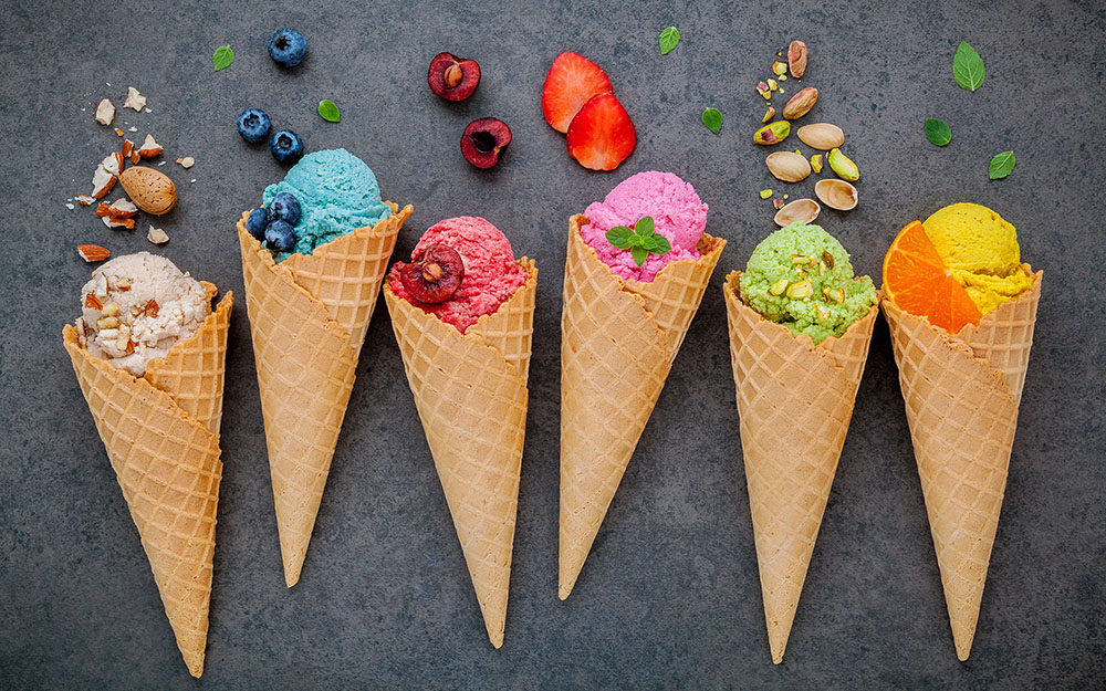 A variety of ice cream cones on a black background